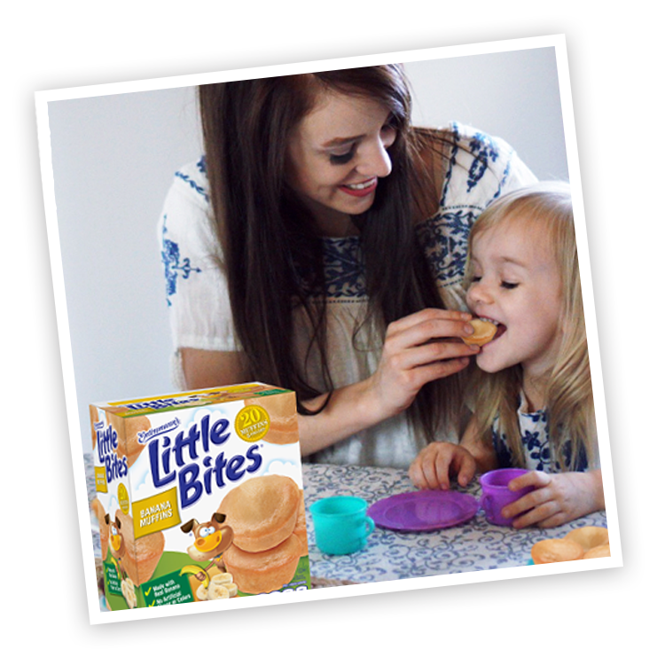 Mother and child with Little Bites Banana muffins package